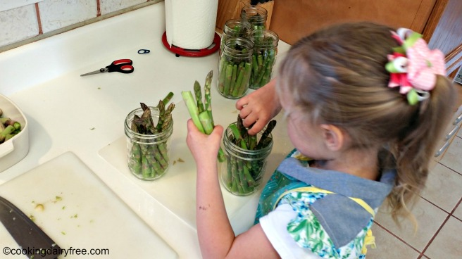 packing the jars with asparagus